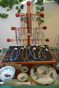 Handmade jewelry and pottery is now available.