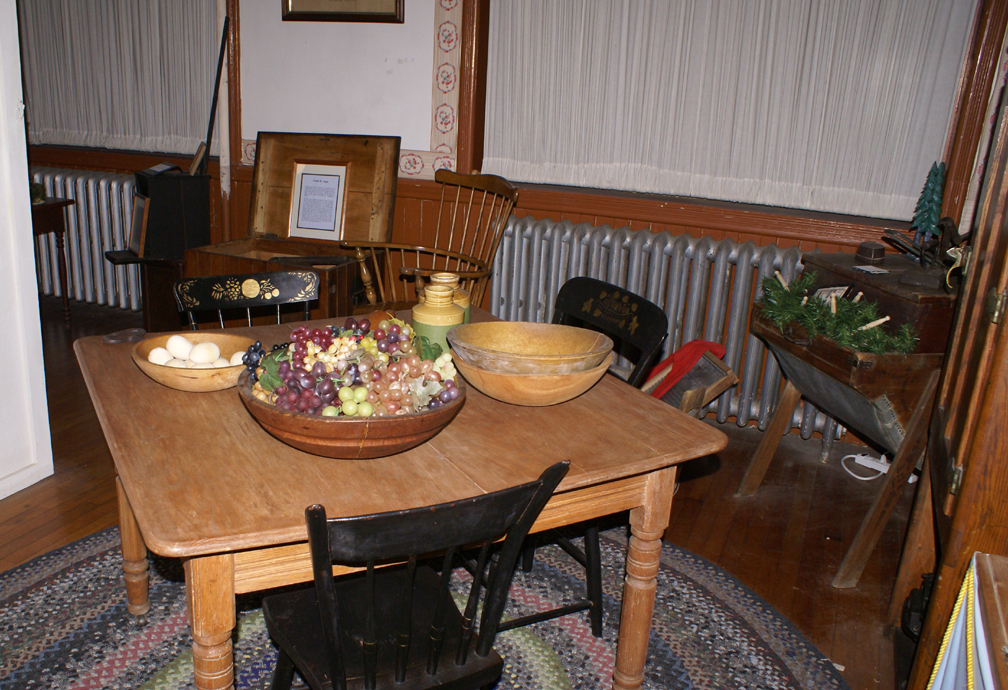 . . . compared to a simple kitchen table with a pre-electronic vacuum cleaner (invented by a BRAM alumnus) in the background