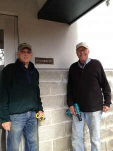 "David Hoeh and Jim Alic attached ""Richard Nye"" plaque to tower last fall."