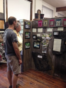 New permanent exhibit by LES's 6th grade, Heidi Baitz's class, explores the Legacy of Irene and compares this storm with the one of 1927.  Newt Rose, summer intern and Sue Pollender, the Museum's president study part of the exhibit.
