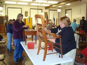 Participants, guided by the museum's director and assistant director learn or hone the art of chair caning.